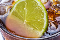 Fresh cocktail with cola drink and lime Stock Photography