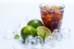 Fresh cocktail with cola drink and lime Royalty Free Stock Image