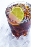 Fresh cocktail with cola drink and lime Royalty Free Stock Photo