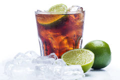 Fresh cocktail with cola drink and lime Royalty Free Stock Images