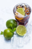 Fresh cocktail with cola drink and lime Stock Photo