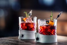 Fresh cocktail drink with ice fruit and herb decoration. Alcoholic, non-alcoholic drink-beverage at the bar counter in the pub. Fresh cocktail drink with ice Stock Image