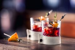 Fresh cocktail drink with ice fruit and herb decoration. Alcoholic, non-alcoholic drink-beverage at the bar counter in the pub. Royalty Free Stock Photography