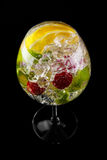 Fresh cocktail. Fresh fruit cocktail on a black background Royalty Free Stock Image