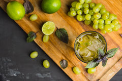 Fresh cocktail with grape, lime and basil leaves. Shallow depth of field royalty free stock images