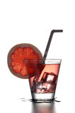 Fresh cocktail with grapefruit, ice and striped drinking straw. Stock Photography