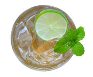 Fresh cocktail lemonade, honey lemon soda with lime slice and mi Royalty Free Stock Photo