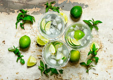 Fresh cocktail with lime, ice and mint Royalty Free Stock Photos