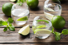 Fresh cocktail with lime and mint Royalty Free Stock Photos