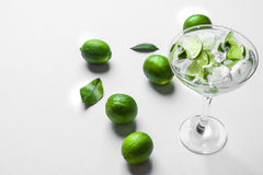 Fresh cocktail with lime slices Stock Images