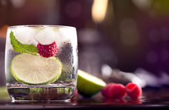 Fresh cocktail. With mint and raspberry on the brown table Stock Image