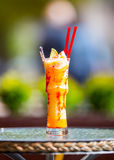 Fresh cocktail with orange, limet, mint and ice. Alcoholic, non-alcoholic drink-beverage Stock Photos