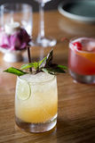 Fresh cocktail with orange, mint and ice, selective focus Royalty Free Stock Image