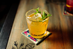 Fresh cocktail with orange, mint and ice, selective focus Royalty Free Stock Photography
