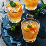 Fresh cocktail with orange, mint and ice Royalty Free Stock Photography