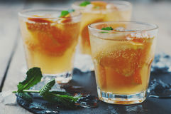 Fresh cocktail with orange, mint and ice Stock Photography