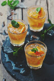 Fresh cocktail with orange, mint and ice Stock Photo