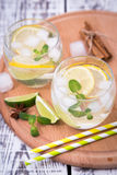 Fresh cocktail with soda, lime and lemon on a wooden background Royalty Free Stock Image