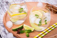 Fresh cocktail with soda, lime and lemon on a wooden background Stock Photography