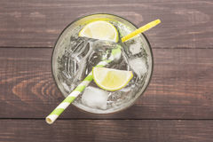 Fresh cocktail with soda, lime on a wooden background Stock Photo