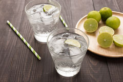 Fresh cocktail with soda, lime on a wooden background royalty free stock photography