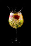 Fresh cocktail with splash. On a black background Royalty Free Stock Images