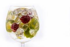 Fresh cocktail with splash. Fresh fruit cocktail on a white background Stock Photos