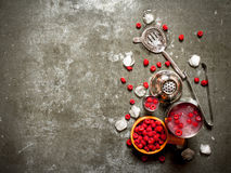 Fresh cocktail of wild raspberries with ice. On the stone table Royalty Free Stock Photo