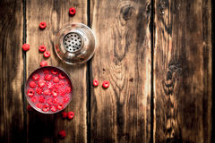 Fresh cocktail of wild raspberries in a shaker. On a wooden table royalty free stock photography