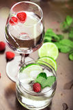 Fresh cocktails with mint and raspberry. On the brown table Royalty Free Stock Image
