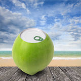 Fresh coconut with can open tool on top, Summer time Royalty Free Stock Image