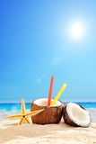 Fresh coconut cocktail on a sandy beach Royalty Free Stock Photos