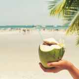 Fresh coconut cocktails with in woman hands on tropical beach Royalty Free Stock Photo