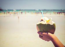 Fresh coconut cocktails with in woman hands on tropical beach - vacation in summer Stock Photography