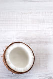 Fresh coconut cut in half. Coconut cut in half on white wooden background Stock Photo