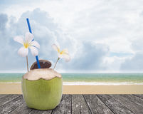 Fresh coconut drink with nice beach Royalty Free Stock Photography