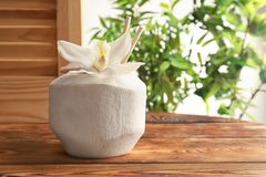 Fresh coconut drink in nut. On wooden window sill stock images