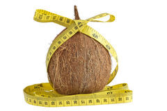 Fresh coconut with measuring tape Royalty Free Stock Images