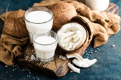 Fresh coconut milk in glass stock images