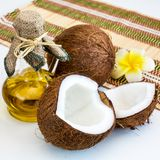Fresh coconut and oil for alternative therapy Stock Images