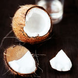 Fresh Coconut over dark wooden background. Close up of coco nut Stock Photo