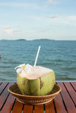 Fresh Coconut. Sea view concept with coconuts attached by flower at Sokha Beach resort, Sihanouk Ville, Cambodia Stock Photo