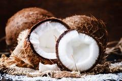 Fresh coconut, selective focus food still life. Fresh coconut on wooden table, selective focus food still life Royalty Free Stock Photo