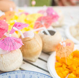 Fresh coconut serve on the table Stock Image