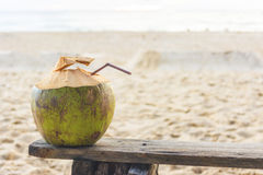 Fresh coconut water on The old wooden chair at beach in Phuket , Stock Photos