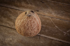 Fresh coconuts on old wooden Stock Images