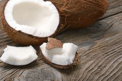 Fresh coconuts on old wooden table. Stock Images