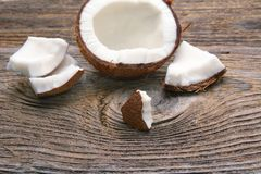 Fresh coconuts on old wooden table. Fresh coconuts on old wooden table Stock Photo