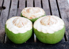 Fresh coconuts ready to serve Royalty Free Stock Image