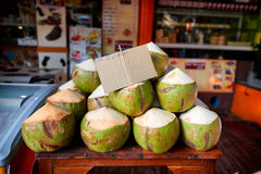 Fresh coconuts for sale on local market in Thailand Stock Photo
